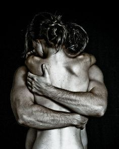 man-holding-woman-arms